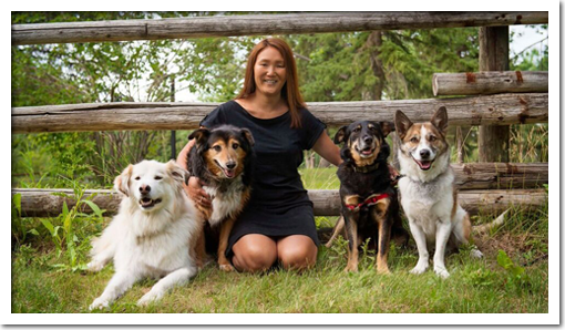 Photo of Cathryn Hanssen with her four dogs