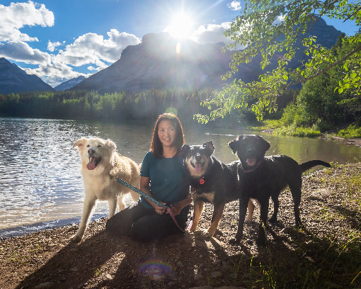 Photo of Cathryn Hanssen with her three dogs